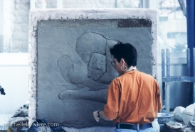 Step 2: Continue building and refining the relief sculpture in clay
