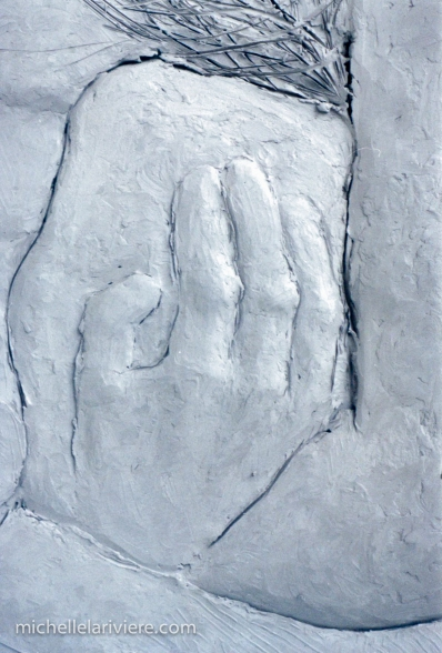 Step 2: (Detail) Continue building and refining the relief sculpture in clay