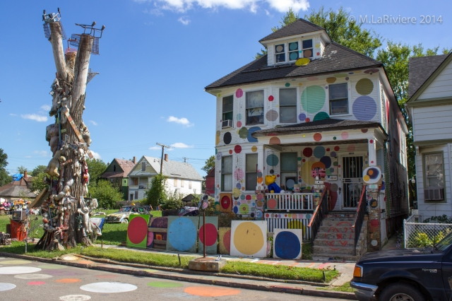 The famous Polka Dot House still standing with the decorated tree beside it